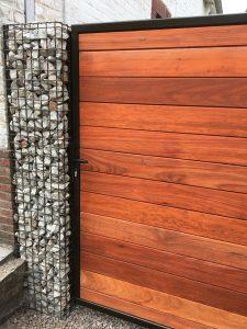 tuinpoort met steenkorven